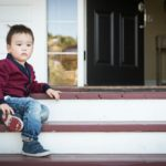 bored kid on porch