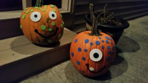 pumpkins decorated with foam stickers